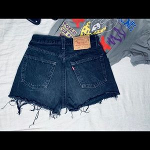 Vintage Levi 501s black distressed denim shorts.
